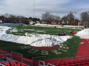 snow removal on football field