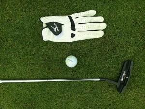 golf glove, ball and club