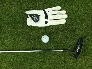golf club, ball and glove
